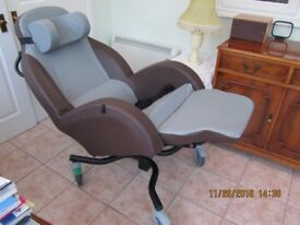 Tilt in space easy chair.
