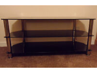 Glass T V stand for up 50inch T V, Dark glass and chrome, condition like new