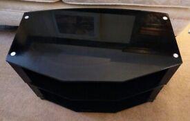 Black glass TV stand. 3 shelves. Good condition. No damage.