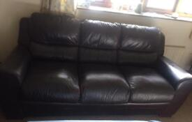 Dark brown 3 seater sofa.