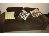 Brown fabric sofa and armchair