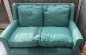 Free green sofa - two seater, comfy & good condition