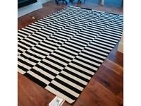 very large flat-woven hand-made wool rug with anti-slip mesh can deliver