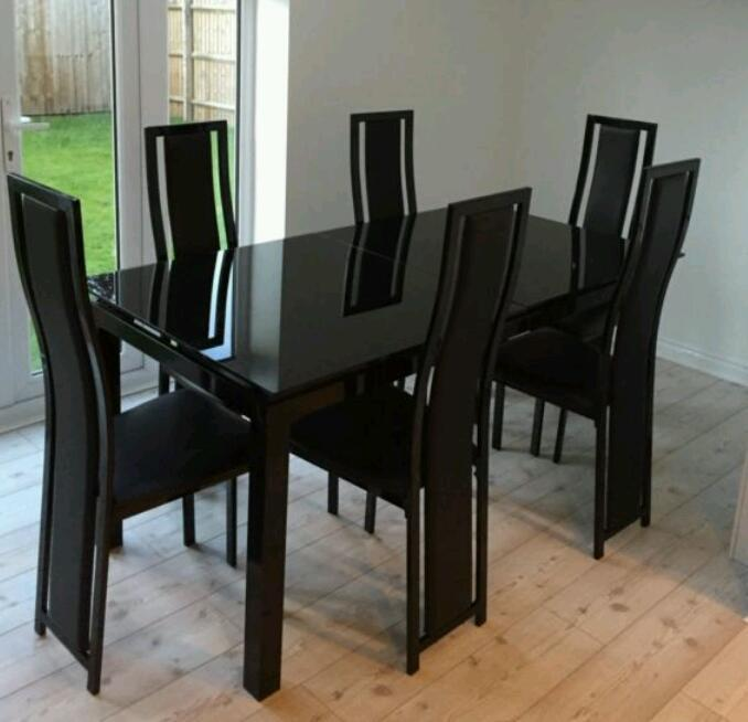 harveys noir black glass extendable dining table and 6