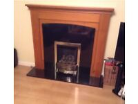 Fire surround with black granite fire surround and hearth, fire excluded