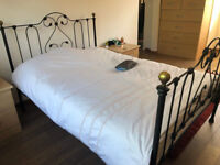 Beautiful wrought iron bed frame w DREAMS magnificient 7 mattress Potters Bar