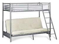 Bunk bed frame and top mattress .