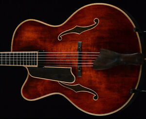 Left handed Eastman 7 string archtop guitar and h/s case