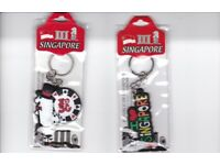TWO SINGAPORE KEYRINGS BRAND NEW