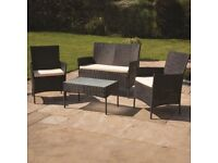 4piece rattan set Inc cushions and free delivery