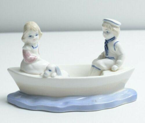 Vintage Ceramic Figurine Girl and Boy in Boat /w Dog