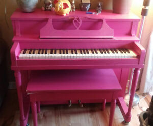 Pink apartment-sized piano