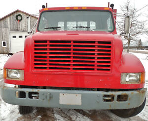 International 4700 flatbed service truck with lift gate