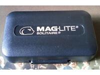 cased mini maglite