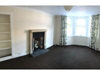 Large 2 bedroom flat in Lanark. Full DG & gas CH. Off road parking. Front & rear garden with patio.