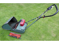 Electric cylinder lawn mower., with grass box and 45-foot lead. Old but excellent working order.