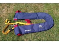 Life jacket with safety harness