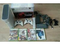 Xbox 360 complete console with two controllers and games inbox and 60gb hard drive