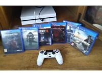 PlayStation 4 (white) with 5 good games