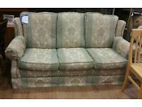 Patterned green/cream 3 seat sofa.