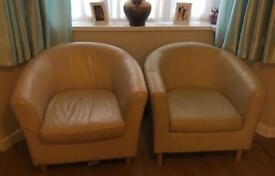 2 cream tub chairs
