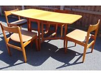 vintage reto 60`s 70`s extendable teak dining table and four matching chairs