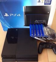 PS4 in box with 5 Games