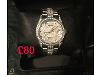 Silver iced out Rolex automatic Swiss movement