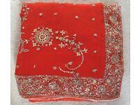 Orange sari, stitches blouse size 8-10.