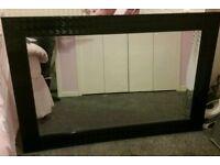 Large black framed rectangular mirror