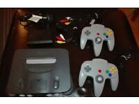Nintendo 64 console with games