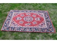 Rug by NEXT in new condition with a traditional symmetrical Pattern size 120cm x 165cm