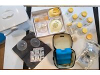Medela breast pump with lots of accessories