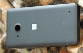 A Microsoft Windows Lumia 550 with wallet