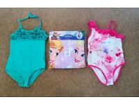 Two lovely girls swimming costumes, (Age 5-6 Years) brand new Frozen poncho towel & armbands