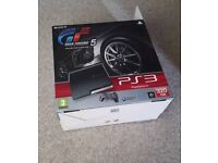 Boxed PS3 with games and 2 controllers