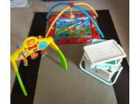 Babies play matt, musical lay and play centre and a change case.