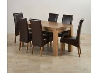 Dining table in oak with 6 black chairs