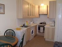 A spacious double bedroom in a two-bedroom flat at Polwarth