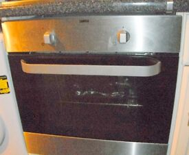 Zanussi Electric Fan Oven,4 Ring Electric Hob, Extractor Hood with Chimney all in Stainless Steel.
