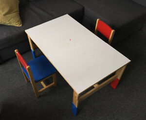 Very sturdy child's adjustable table or desk with 2 chairs.