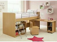 A kids single bunk bed with desk