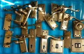 Brass door handles and light switchs