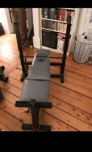 Folding weight bench and 45 lb bar