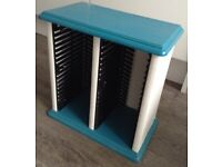 CD RACK painted in turquoise Aqua blue. Holds 40