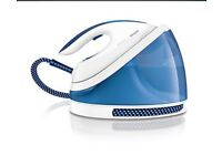 Blue and white philips garment steamer