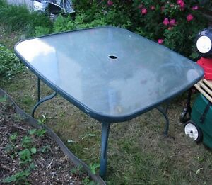 Square glass top Patio Table in good condition