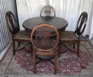 A unique antique dining set (round/oval table/4 chairs), refinis