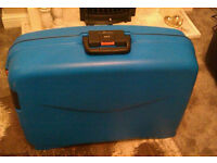 Large solid family size suitcase blue with combination lock.