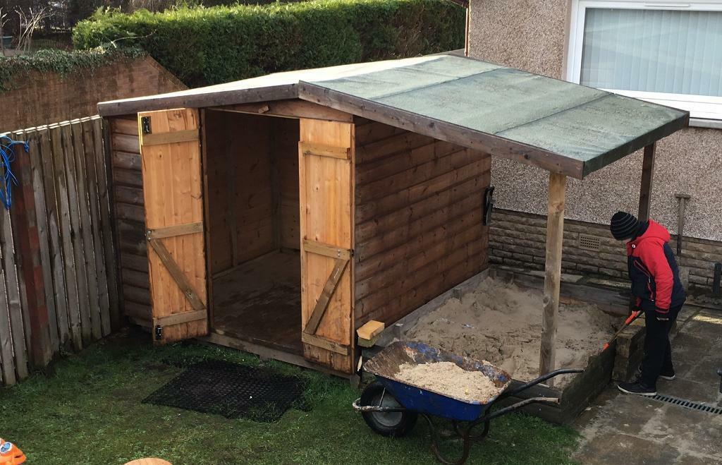 garden shed with log store canopy in bathgate west